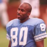 Ex-NFL star collapses and is taken to the hospital.