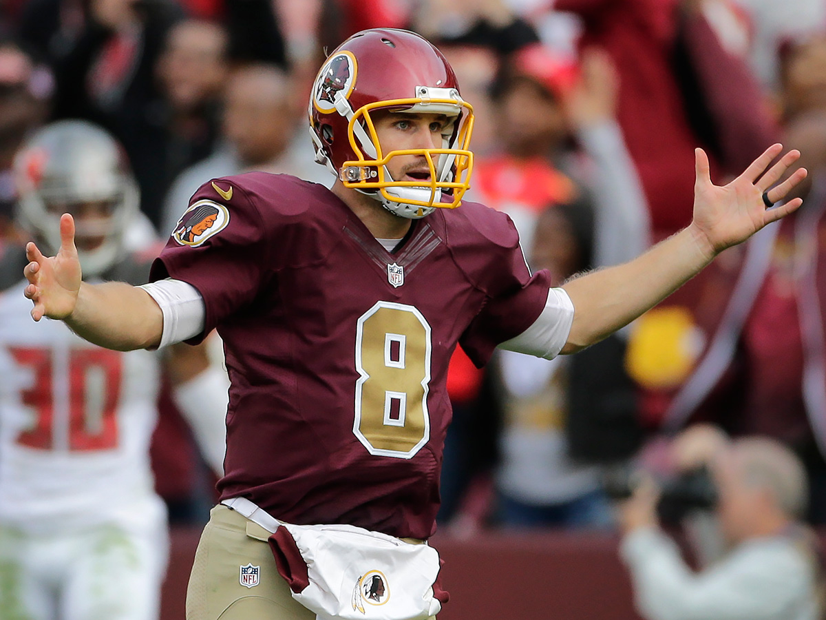 Washington Redskins quarterback Kirk Cousins (8) celebrates tight end Jordan Reed's tying touchdown during the second half of an NFL football game against the Tampa Bay Buccaneers in Landover, Md., Sunday, Oct. 25, 2015. The Washington Redskins defeated the Tampa Bay Buccaneers 31-30. (AP Photo/Mark Tenally)