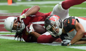 Sep 18, 2016; Glendale, AZ, USA; Arizona Cardinals wide receiver Larry Fitzgerald (11) makes a touchdown catch against Tampa Bay Buccaneers cornerback Brent Grimes (24) during the first half at University of Phoenix Stadium. Mandatory Credit: Joe Camporeale-USA TODAY Sports