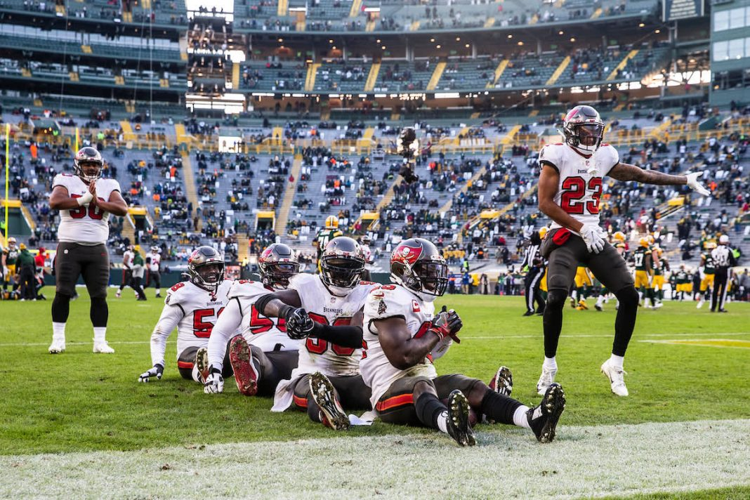 GREEN BAY, WI - JANUARY 24, 2021 - Inside Linebacker Devin White #45, Outside Linebacker Jason Pierre-Paul #90, Defensive Tackle Rakeem Nunez-Roches #56, Outside Linebacker Shaquil Barrett #58, and Cornerback Sean Murphy-Bunting #23 of the Tampa Bay Buccaneers celebrate a turnover during the NFC Championship game between the Tampa Bay Buccaneers and Green Bay Packers at Lambeau Field. The Buccaneers won the game 31-26. Photo By Kyle Zedaker/Tampa Bay Buccaneers