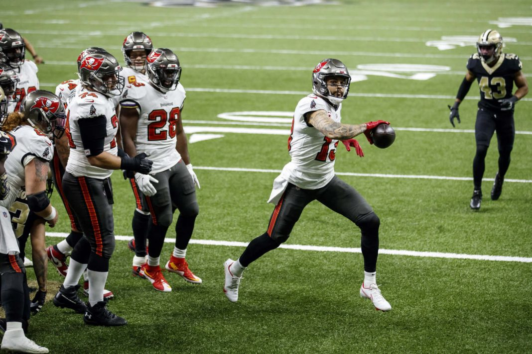 NEW ORLEANS, LA - JANUARY 17, 2021 - Wide Receiver Mike Evans #13 of the Tampa Bay Buccaneers celebrates a touchdown during the NFC Divisional Round game between the Tampa Bay Buccaneers and New Orleans Saints at Mercedes-Benz Superdome. The Buccaneers won the game, 30-20. Photo By Matt May/Tampa Bay Buccaneers