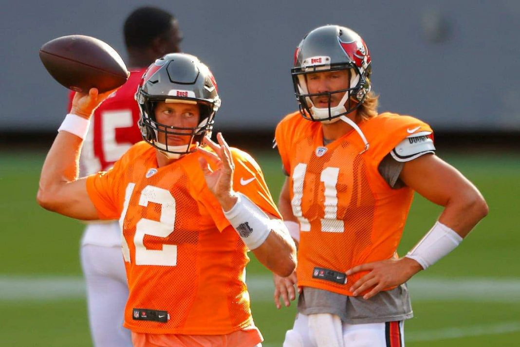 The Buccaneers' Tom Brady throws in front of Blaine Gabbert | Mike Ehrmann/Getty Images