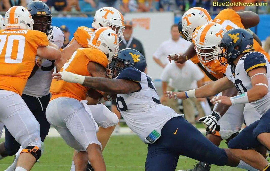 West Virginia defensive tackle Darius Stills (56) scrambles to make a tackle on Tennessee's Tim Jordan (9)