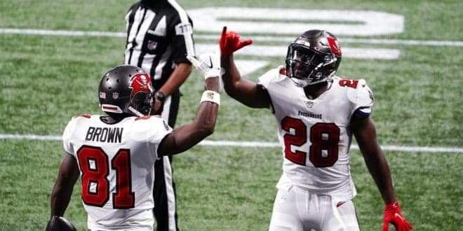 Tampa Bay Buccaneers wide receiver Antonio Brown (81) celebrates his touchdown with Tampa Bay Buccaneers running back Leonard Fournette (28) during the second half of an NFL football game against the Atlanta Falcons, Sunday, Dec. 20, 2020, in Atlanta. The Tampa Bay Buccaneers won 31-27. (AP Photo/Brynn Anderson)