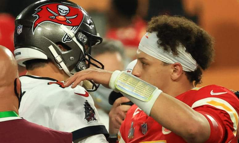 Tom Brady #12 of the Tampa Bay Buccaneers and Patrick Mahomes #15 of the Kansas City Chiefs speak after Super Bowl LV at Raymond James Stadium on February 07, 2021 in Tampa, Florida. The Buccaneers defeated the Chiefs 31-9. (Photo by Mike Ehrmann/Getty Images)