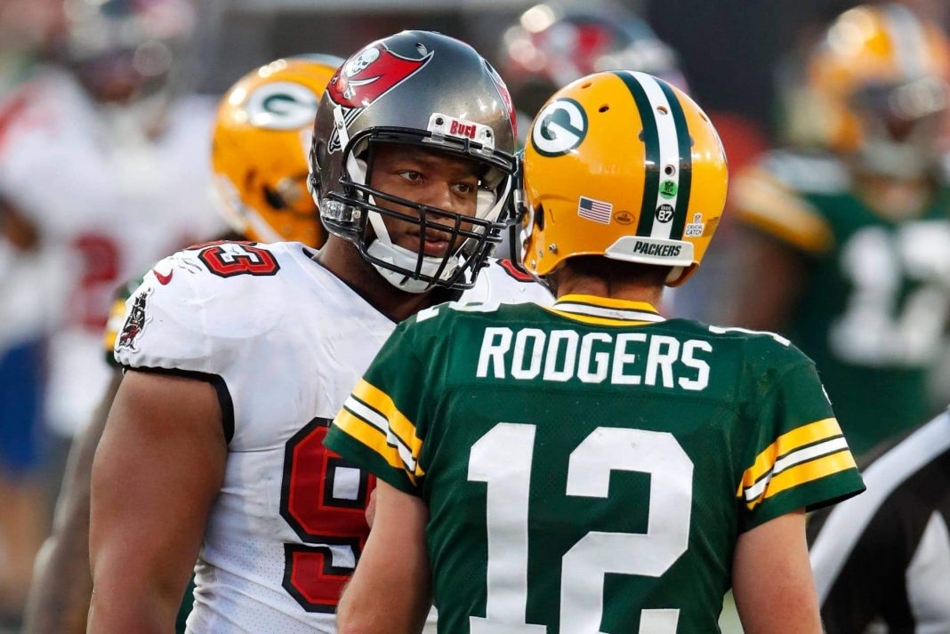 Tampa Bay Buccaneers defensive end Ndamukong Suh and Green Bay Packers quarterback Aaron Rodgers will renew their often salty rivalry Sunday when the Buccaneers face the Packers in the NFC championship game. (Jeff Haynes/AP Images for Panini)