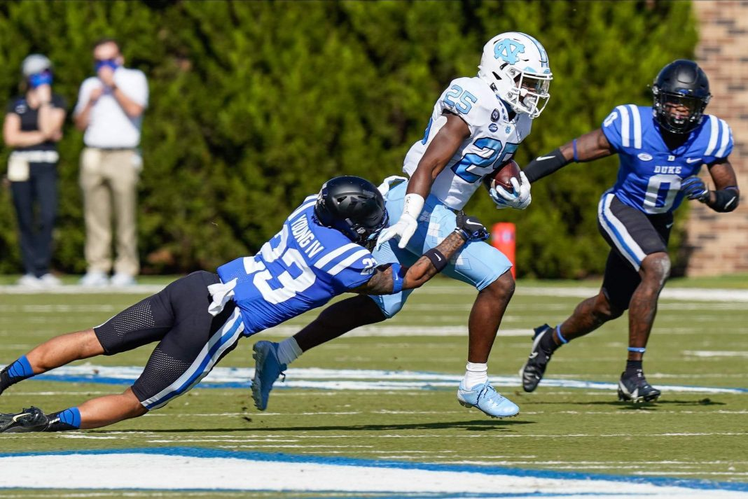 Running back Javonte Williams/via Jim Dedmon USA TODAY