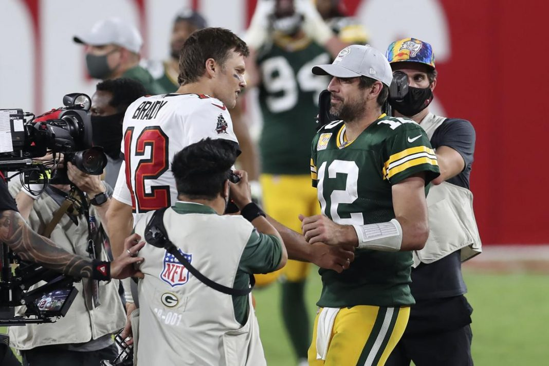 Buccaneers quarterback Tom Brady shakes hands with Packers quarterback Aaron Rodgers after the Bucs' victory on Oct. 18 in Tampa, Fla. MARK LOMOGLIO, ASSOCIATED PRESS