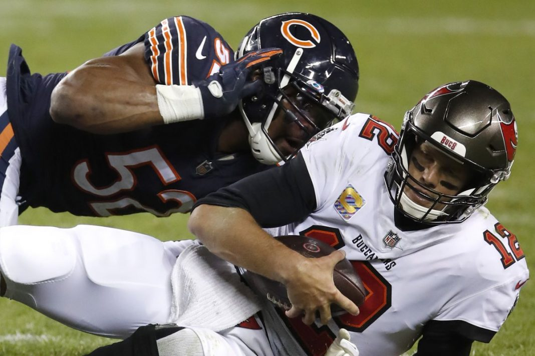 Buccaneers quarterback Tom Brady is sacked by Khalil Mack of the Chicago Bears/via Associated Press