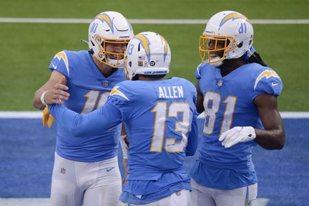 From left, Los Angeles Chargers quarterback Justin Herbert (10), wide receiver Keenan Allen (13), and wide receiver Mike Williams (81) celebrate Allen's touchdown during the Chargers' 34-28 win over the New York Jets. (AP Photo/Kyusung Gong)