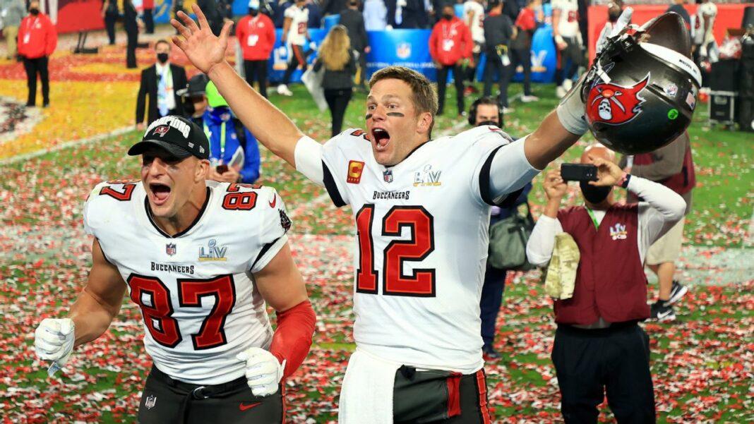 Buccaneers quarterback Tom Brady and tight end Rob Gronkowski celebrate the Buccaneers Super Bowl LV victory/via ESPN