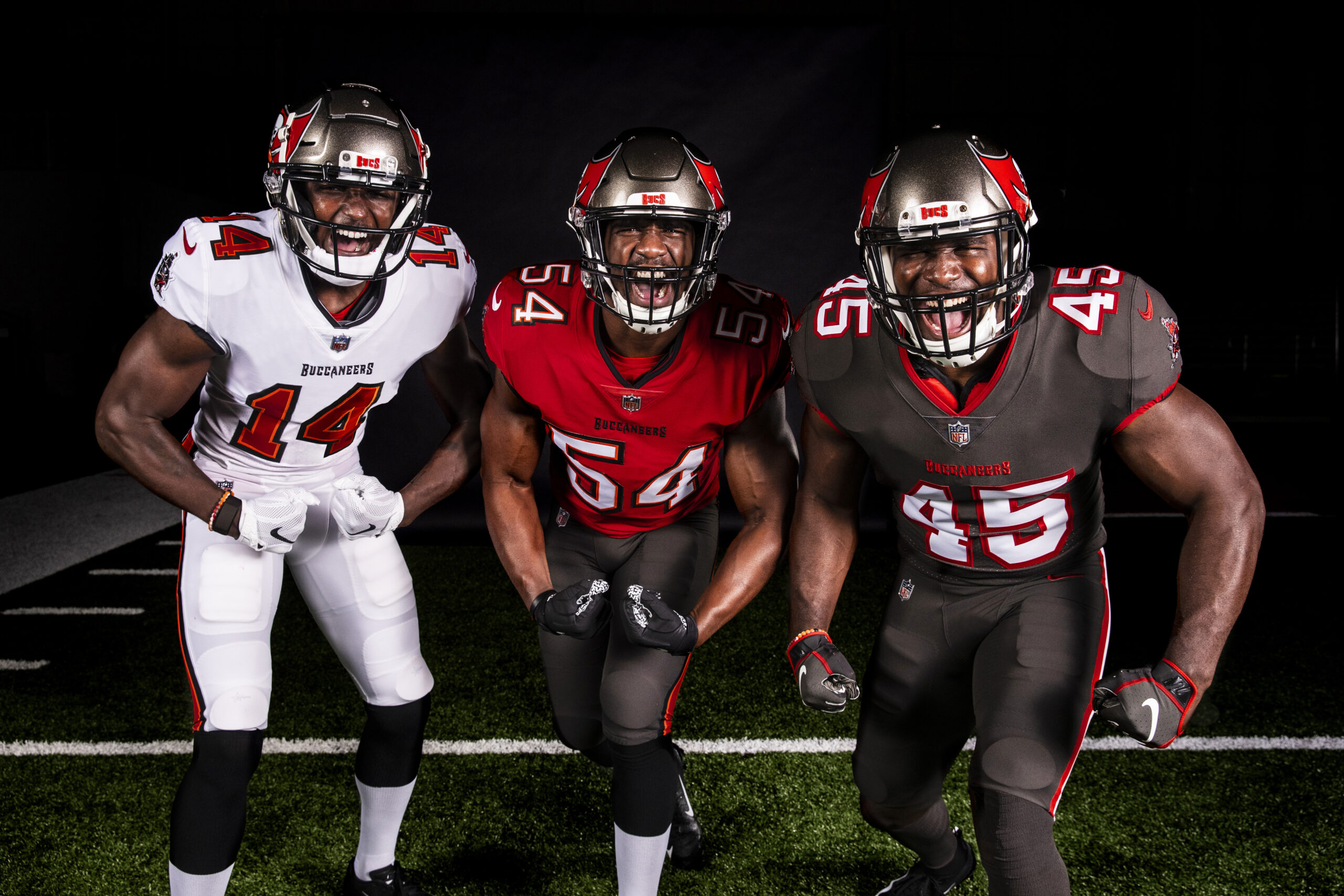Tampa Bay Bucs wide Receiver Chris Godwin , left, inside linebacker Lavonte David, center, and inside linebacker Devin White, right, show off the team's new uniform combinations/via Kyle Zedaker,Tampa Bay Buccaneers