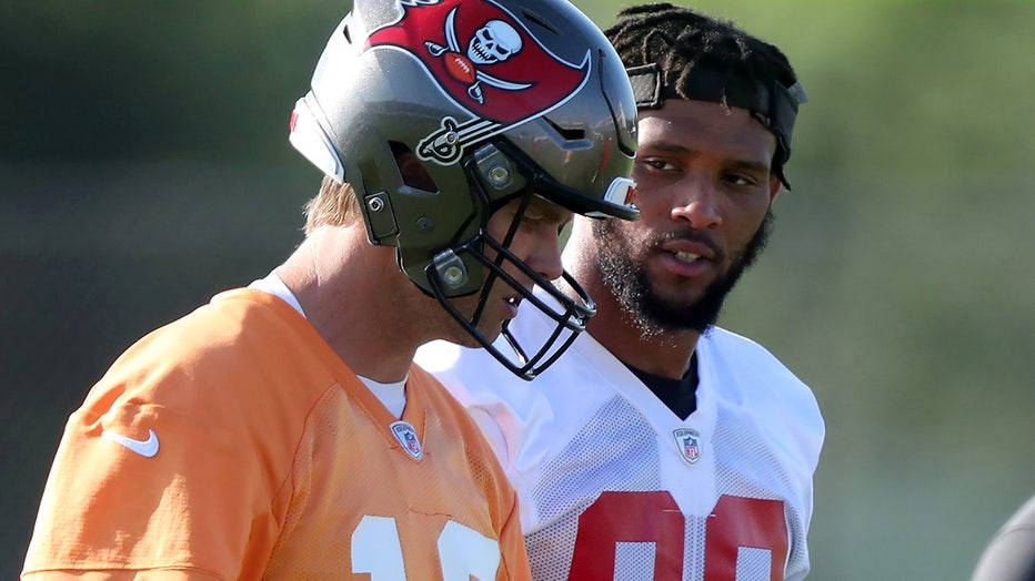 Buccaneers quarterback Tom Brady and tight end O.J. Howard/via Cliff Welch/Icon Sportswire via Getty Images