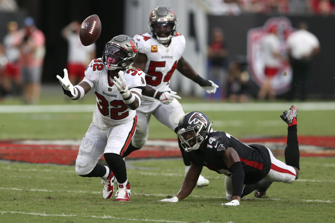 Tampa Bay Buccaneers safety Mike Edwards (32) intercepts a pass by Atlanta Falcons quarterback Matt Ryan that was intended for wide receiver Russell Gage (14) and returns it for a score during the second half of an NFL football game Sunday, Sept. 19, 2021, in Tampa, Fla. (AP Photo/Mark LoMoglio)