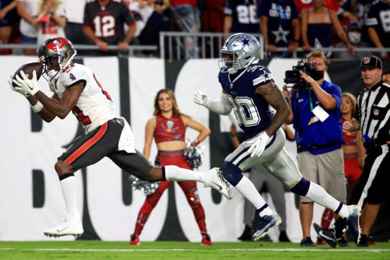 TAMPA, FLORIDA – SEPTEMBER 09: Antonio Brown #81 of the Tampa Bay Buccaneers catches a pass for a touchdown against Anthony Brown #30 of the Dallas Cowboys during the second quarter at Raymond James Stadium on September 09, 2021 in Tampa, Florida. (Photo by Mike Ehrmann/Getty Images)