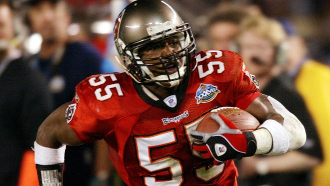 Derrick Brooks runs back an interception in the Super Bowl XXVII win over the Raiders. ROBERT DEUTSCH, USA TODAY SPORTS